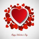 Поздравительная открытка валентинки с различными красными сердцами в предпосылке Стоковое Фото