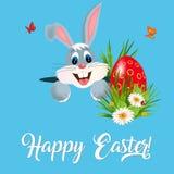 Поздравительная открытка пасхи с красочными яичками и зайчиком Стоковое Фото