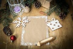 Поздравительная открытка рождества пустая на винтажной предпосылке Стоковые Изображения