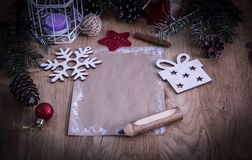 Поздравительная открытка рождества пустая на винтажной предпосылке Стоковые Фотографии RF