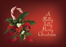 Поздравительная открытка рождества сезонная с тросточкой конфеты Счастливое радостное с Рождеством Христовым Стоковое фото RF