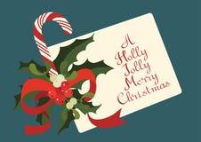 Поздравительная открытка рождества сезонная с тросточкой конфеты Счастливое радостное с Рождеством Христовым Стоковые Изображения