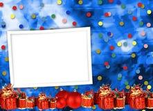 Поздравительная открытка рождества с настоящими моментами на голубой предпосылке стоковые изображения rf