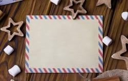 Поздравительная открытка рождества с циннамоном играет главные роли marshmellow Стоковые Изображения
