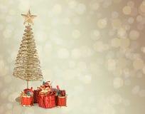 Поздравительная открытка рождества с firtree металла золота Стоковая Фотография