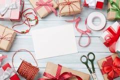 Поздравительная открытка и подарочные коробки рождества Стоковые Изображения