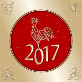 Поздравительная открытка 2017 рождества с петухом Стоковое Фото