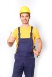 Показывать большого пальца руки работника вверх изолированный на белизне Стоковое Изображение RF