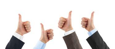 Показывать руки большого пальца руки Стоковые Изображения RF