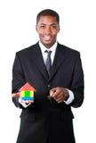 показ дома конструкции бизнесмена новый Стоковые Фото