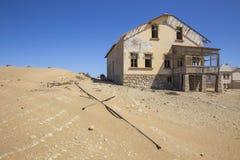 Покинутые дома в Kolmanskop, Намибии Стоковое Фото