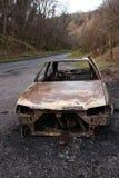 покинутый, котор сгорели автомобиль Стоковое Изображение RF