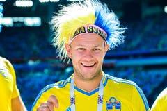 Поклонник футбола футбольной команды соотечественника Швеции стоковое фото rf