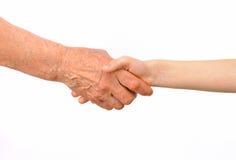 Поколения - рукопожатие бабушки и внучат Стоковая Фотография