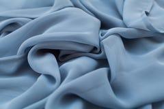 Покрасьте голубое textil, silk ткань с pleats стоковое фото