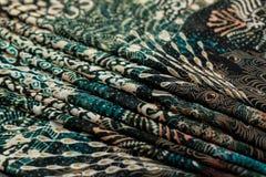 Покрасьте зеленое textil, silk ткань с pleats стоковая фотография