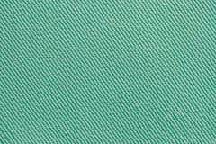 Покрасьте зеленую текстуру ткани, стоковое изображение rf