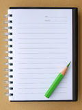 покрасьте карандаш тетради Стоковое Фото