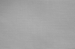 Покрасьте серую текстуру ткани, стоковое фото