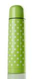 покрасьте сталь stainlees склянки зеленую термо- стоковые фото