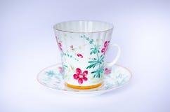 Покрашенная вручную чашка и поддонник Стоковое фото RF