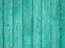 Покрашенная зеленым цветом старая деревянная предпосылка текстуры планки стоковые изображения rf