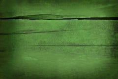 Покрашенная зеленым цветом треснутая старая предпосылка деревянной доски Стоковые Фотографии RF