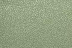 Покрашенная оливкой кожаная grained картина предпосылки текстуры Стоковые Фотографии RF