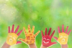 покрашенная рука ребенка Стоковые Изображения