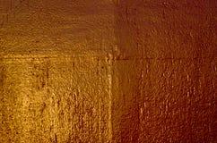 Покрашенная старая стена металла предпосылка золотистая Стоковые Фотографии RF