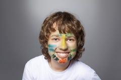 покрашенная сторона мальчика стоковые фото