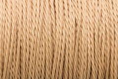 Покрашенная сливк предпосылка шнура Стоковая Фотография