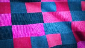 Покрашенная ткань в квадрате двигает в ветер Анимация предпосылки покрашенной ткани Стоковые Изображения