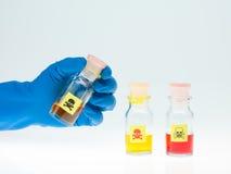 Покрашенная ядовитая жидкость в 3 различных бутылках Стоковое Изображение RF
