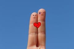 2 покрашенного пальца, концепция влюбленности Стоковое Изображение