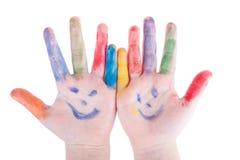 Покрашенное красочное ладоней рук детей изолированным на белой предпосылке Стоковые Изображения