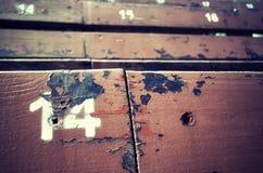 14 покрашенное на старом деревянном месте Стоковые Изображения