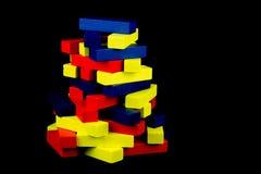 Покрашенные деревянные блоки на черной предпосылке Стоковые Изображения RF