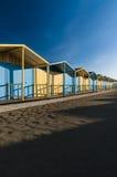 Покрашенные кабины на пляже стоковое фото