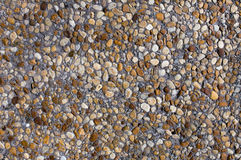 Покрашенные камни на серой стене Стоковое фото RF