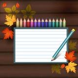 Покрашенные карандаши на деревянной текстуре Стоковая Фотография