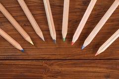 Покрашенные карандаши на древесине Стоковые Изображения RF