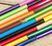 Покрашенные карандаши на древесине Стоковая Фотография