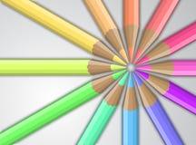 Покрашенные карандаши на серой предпосылке Стоковые Изображения