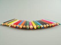 Покрашенные карандаши на таблице Стоковое Изображение RF