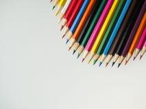 Покрашенные карандаши на таблице Стоковые Фотографии RF