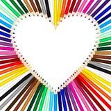 Покрашенные карандаши формируя рамку сердца Стоковые Изображения