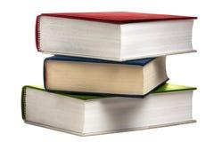 Покрашенные книги книги стога изолированными Стоковое фото RF