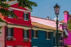 Покрашенные дома на острове Burano Стоковое фото RF