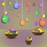 Покрашенные пасхальные яйца и корзины Стоковое Изображение